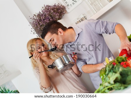 Young couple cooking in the kitchen. - stock photo