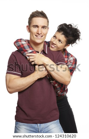 Young couple cuddling and smiling on white background smiling - stock photo