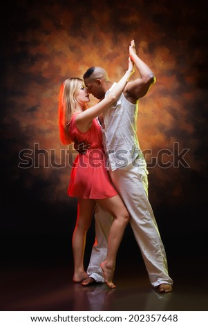 Young couple dances Caribbean Salsa - stock photo