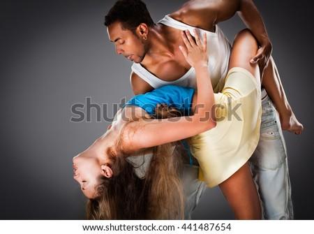 Young couple dances Caribbean Salsa - stock photo
