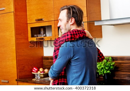 Young couple dancing and having fun in the kitchen  - stock photo