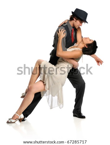 Young couple dancing ballroom dance isolated over white background - stock photo