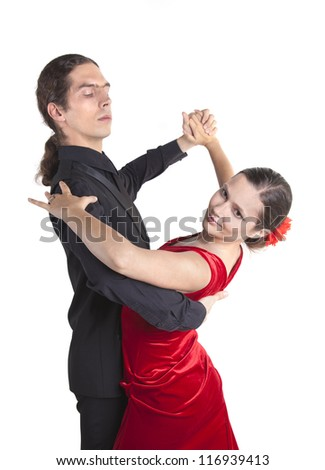 Young couple dancing waltz isolated over white background