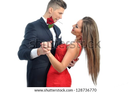 Young couple dancing with red rose - stock photo