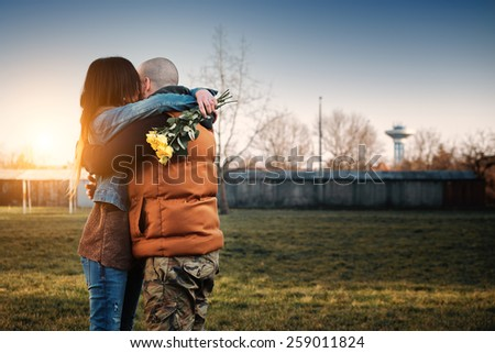 Young couple date in the park - stock photo