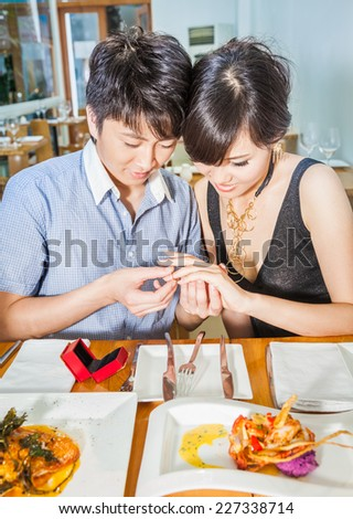 Young couple dating at a restaurant for a romantic dinner. - stock photo