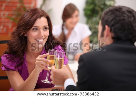 Young couple dating at the restaurant - stock photo