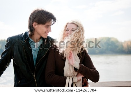 Young couple dating outdoors - stock photo