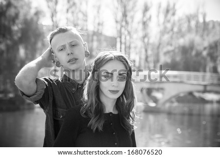 young couple disappointed with relationship she leaving him - stock photo