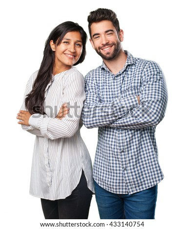 young couple doing a thumb up gesture - stock photo