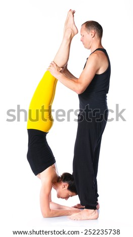 Young couple doing yoga. Isolated on white backgraund - stock photo