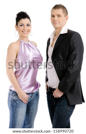 Young couple dressed for party posing together, smiling. Isolated on white background. - stock photo