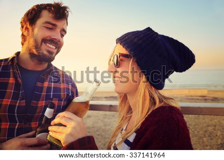 young couple drinking beer - stock photo
