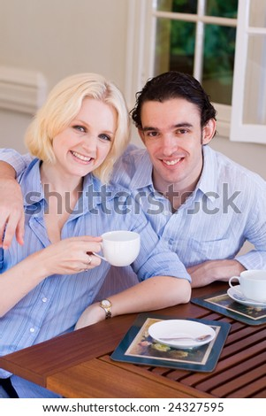 young couple drinking coffee at home - stock photo