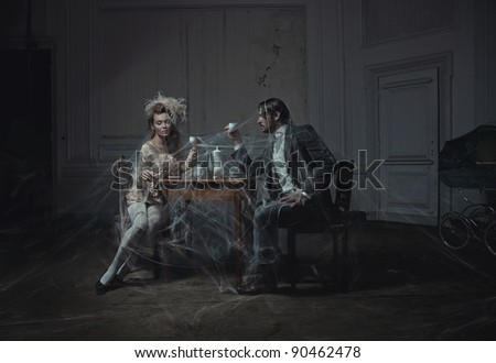 Young couple drinking coffee in an old castle - stock photo