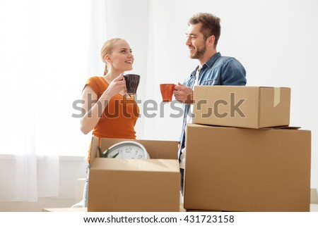 Young couple drinking coffee in the new apartment