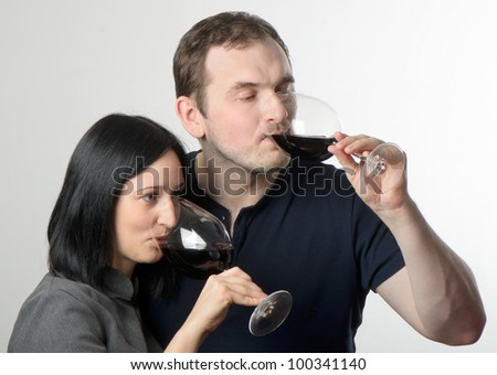 Young couple drinking glasses of red wine