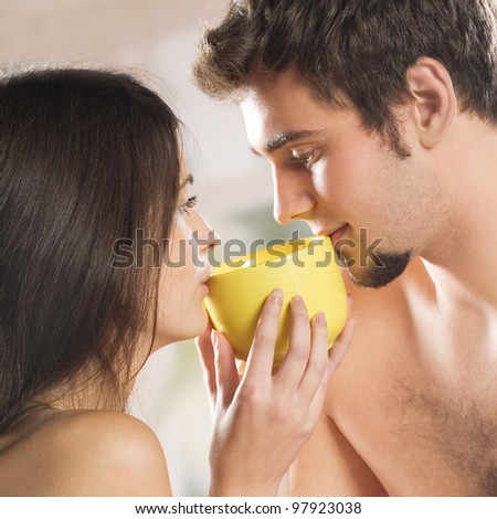 Young couple drinking tea together at home - stock photo