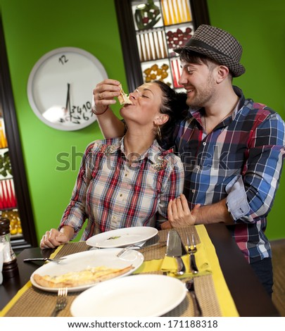 Young couple eating pizza - stock photo