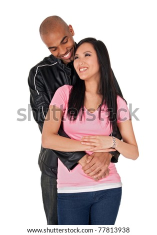 Young couple embracing and smiling - Asian girl with African American boyfriend. - stock photo