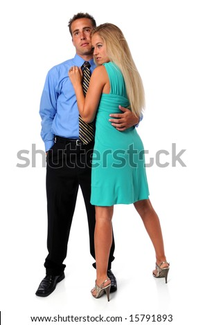 Young couple embracing isolated over a white background