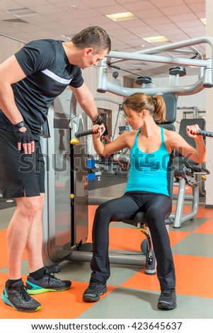 young couple engaged in the gym together