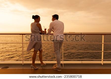 young couple enjoying a cruise holiday - stock photo
