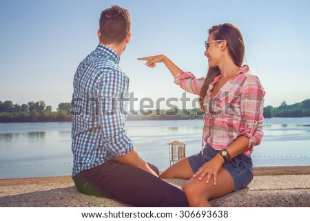 Young couple enjoying a sunny day. - stock photo