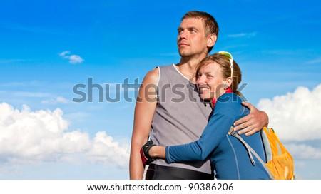 Young couple enjoying a view - stock photo
