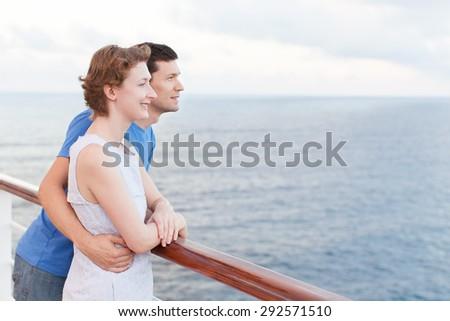 young couple enjoying cruise vacation - stock photo