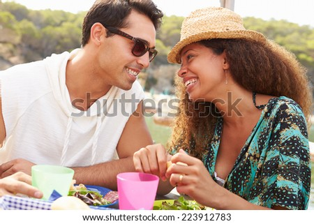 Young Couple Enjoying Lunch Outdoors Together