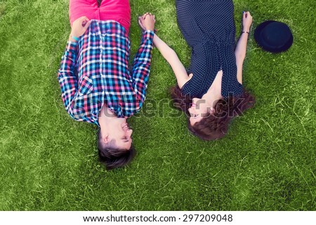 Young couple enjoying on the grass - stock photo