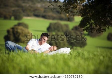Young couple enjoying outdoors on nature. - stock photo