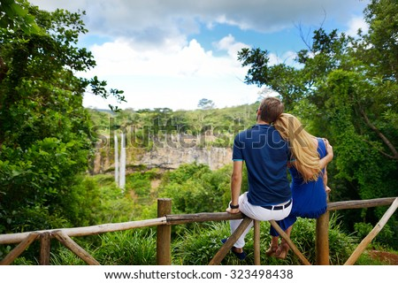 Young couple enjoying perfect view on Chamarel falls of Mauritius - stock photo