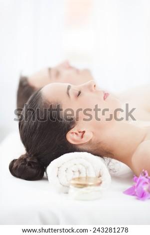Young couple enjoying spa treatment - stock photo