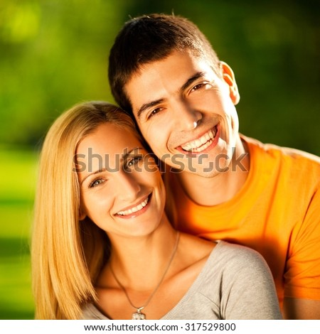 Young couple enjoying sunny day.