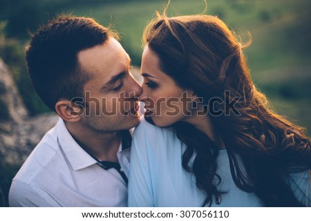Young couple enjoying the sunset in the meadow. wedding style. romantic and love - stock photo