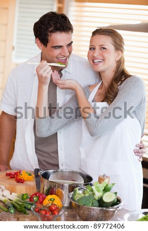 Young couple enjoys preparing dinner together