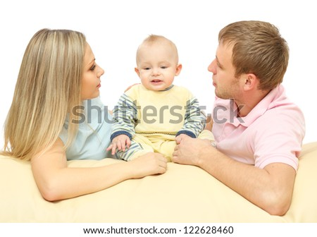 young couple entertained the baby lying down - stock photo
