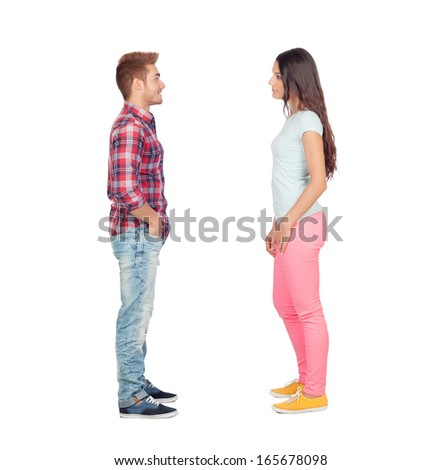 Young couple facing each other isolated on white background - stock photo