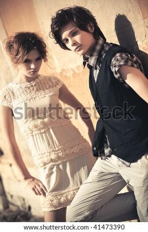 Young couple fashion. Soft yellow tint. - stock photo
