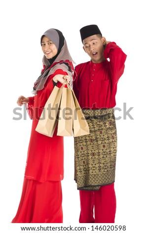 Young couple feel happy holding shopping bags isolated on white