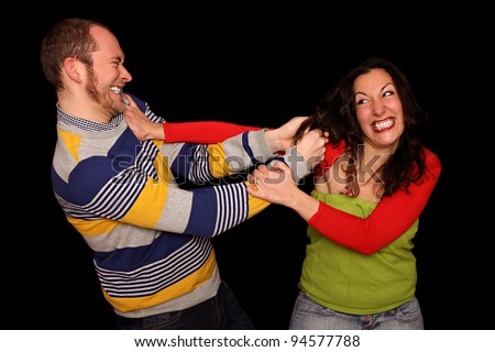 young couple fighting for fun - stock photo
