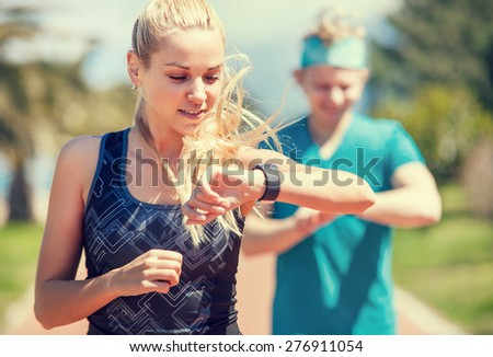 Young couple finishing jogging - stock photo