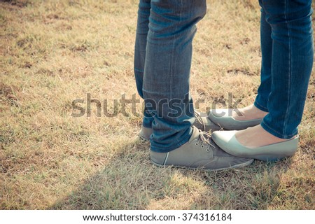 Young couple first kiss on summer warm weather, love standing in garden.