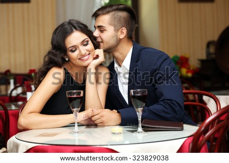 young couple flirting at the restaurant - stock photo