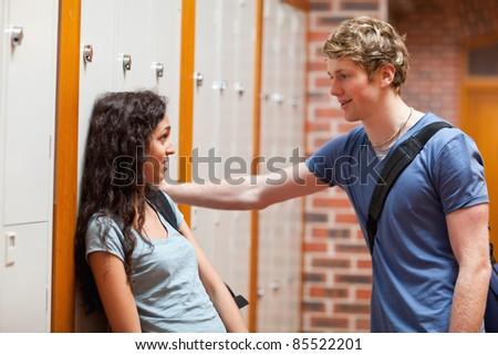 Young couple flirting in a corridor - stock photo