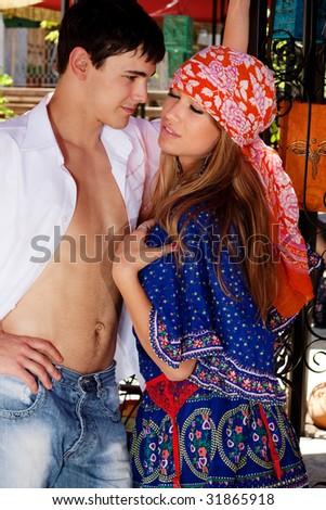 young couple flirting, outdoor shot, summer day - stock photo
