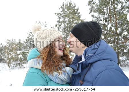 Young couple gently kissing and looking at each other