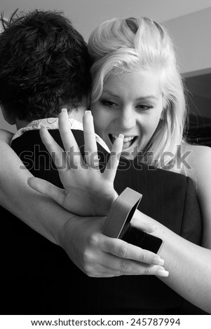 Young couple getting engaged  - stock photo